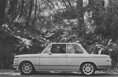The BMW 2002 near a stream